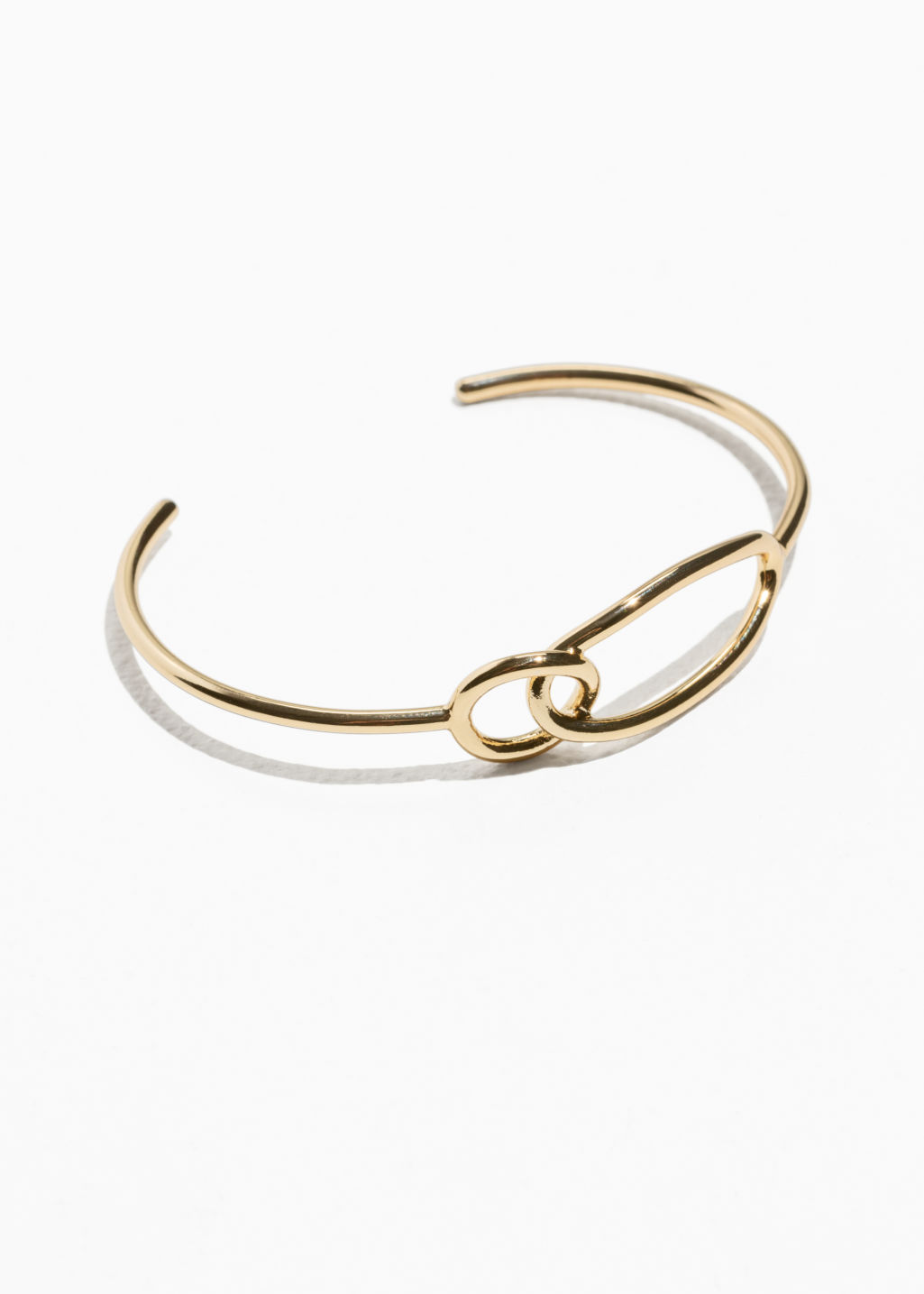 Front image of Stories oval ring cuff in gold