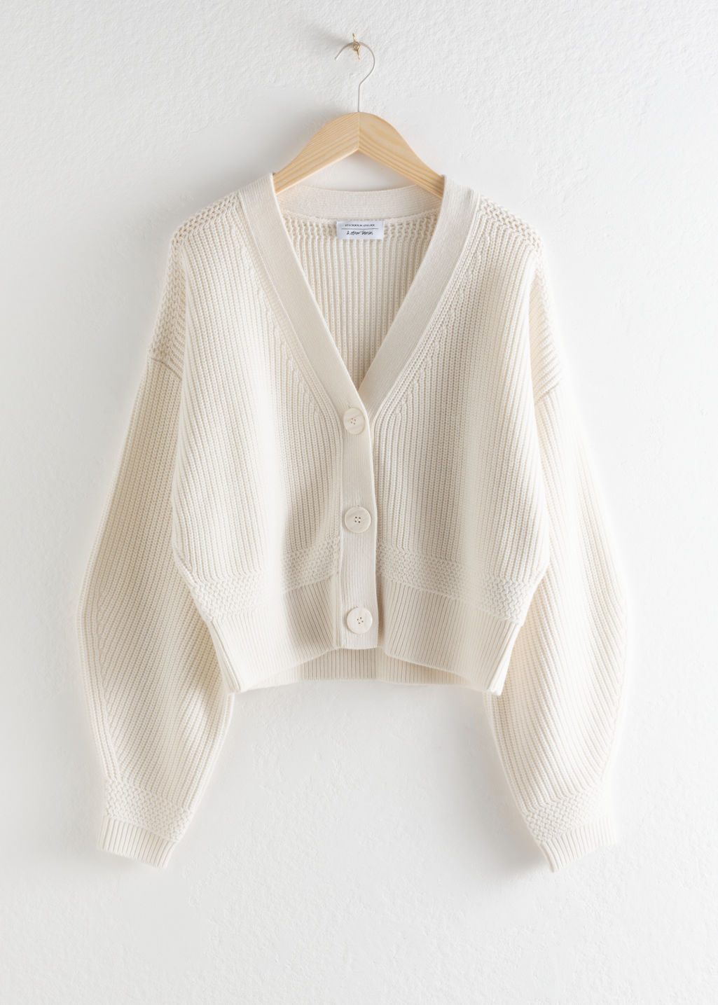 Front image of Stories wool button sweater in white