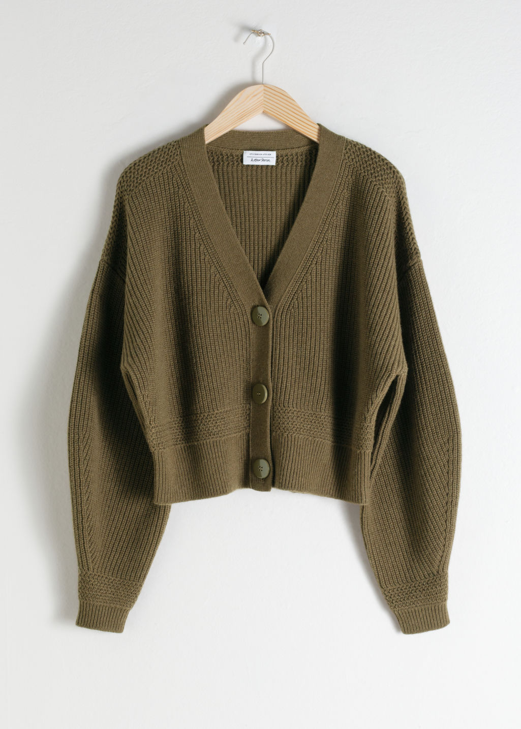 Front image of Stories cropped cardigan in green