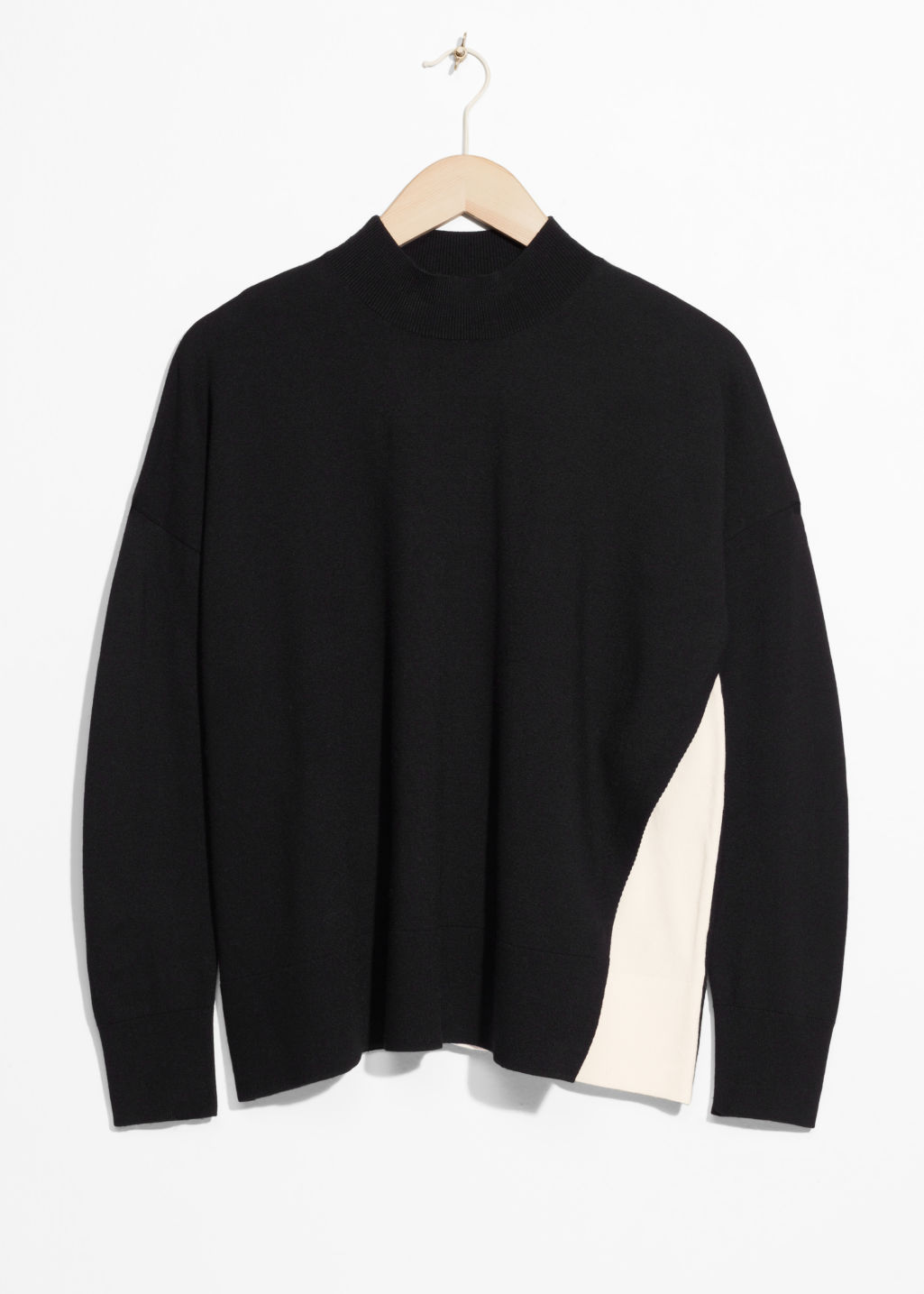 Front image of Stories overlap color block sweater in black