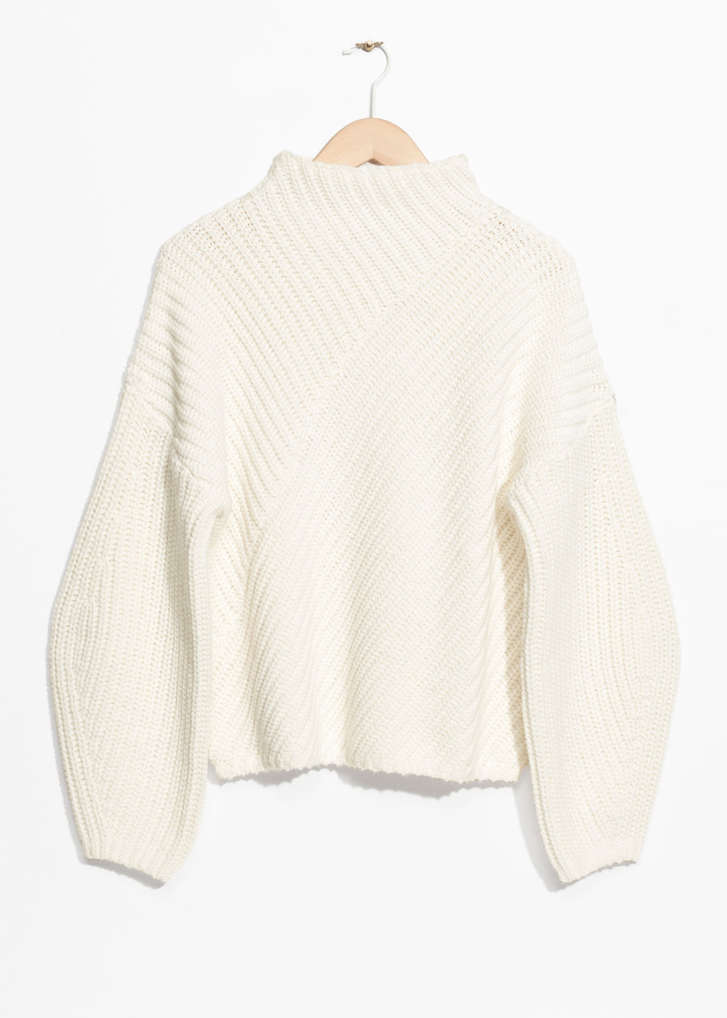 Front image of Stories criss cross sweater in white