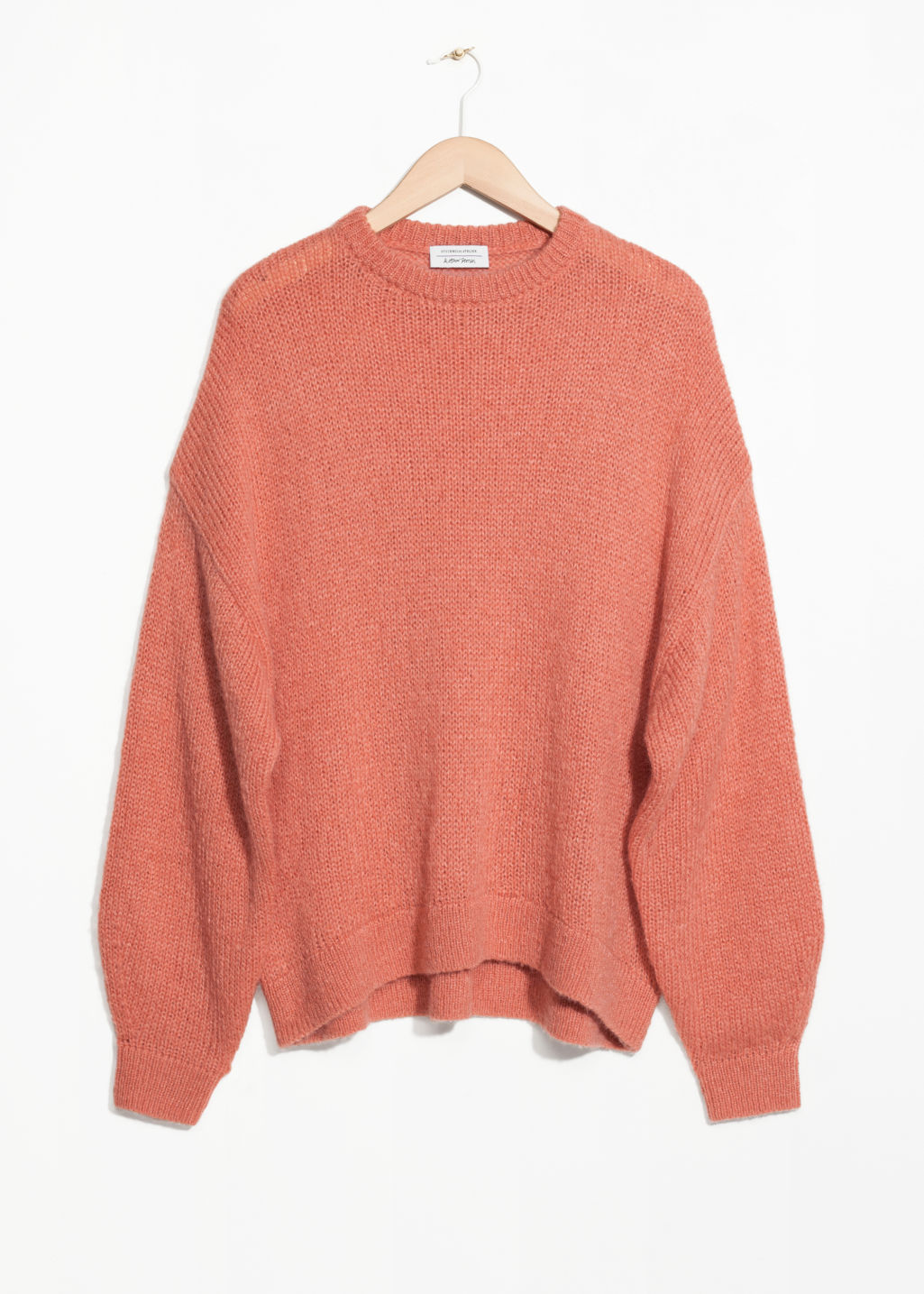 Front image of Stories oversized sweater in orange