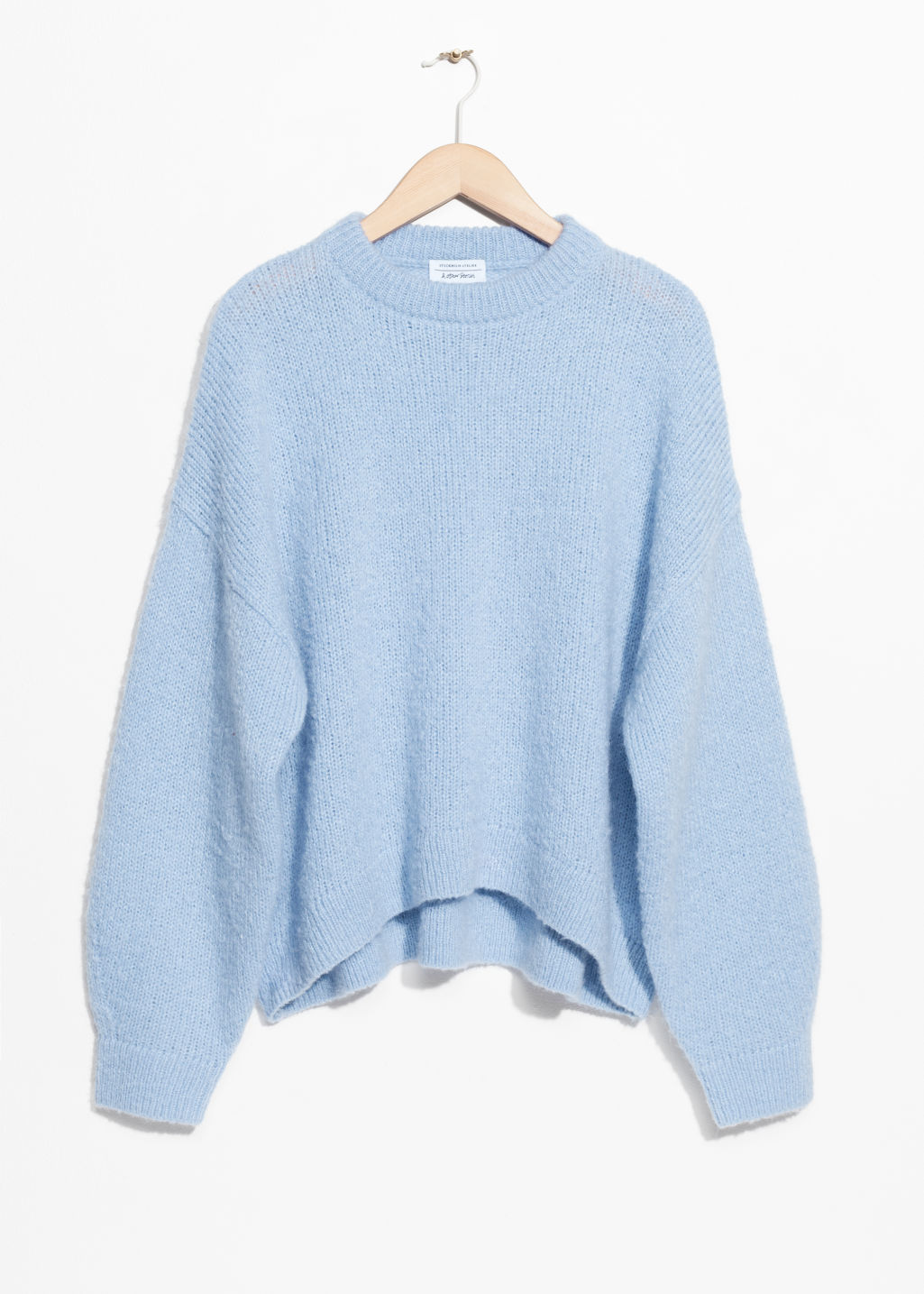 Front image of Stories oversized sweater in blue