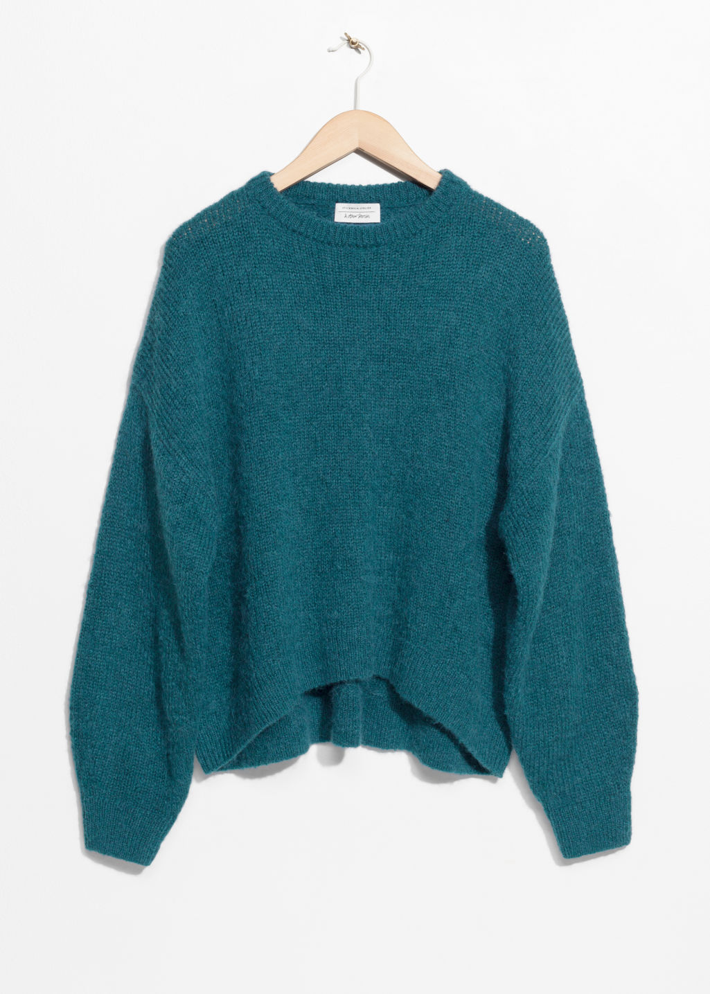 Front image of Stories oversized sweater in turquoise