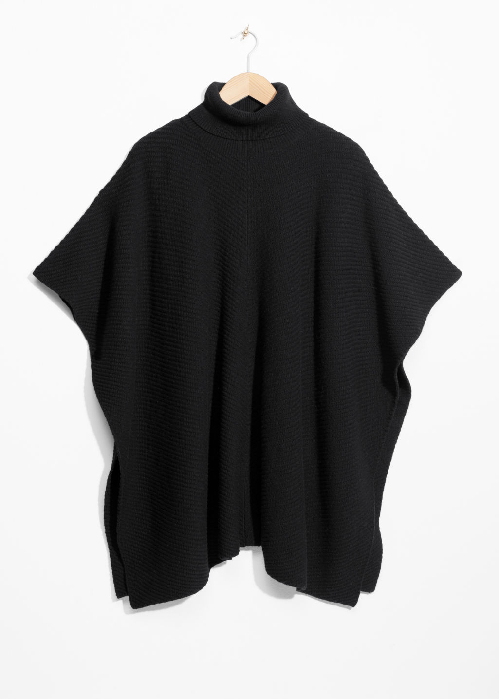 Front image of Stories turtleneck cape in black