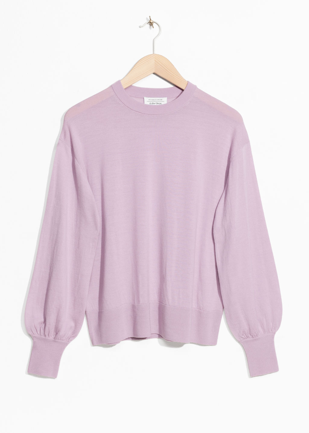 Front image of Stories puffy merino wool sweater  in pink