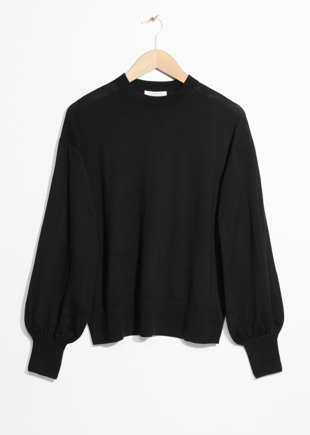 Front image of Stories puffy merino wool sweater  in black