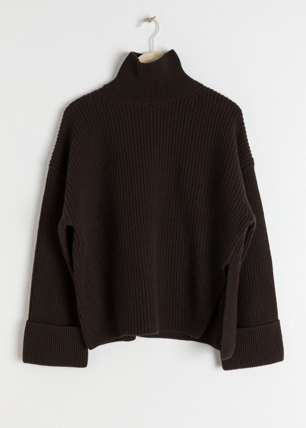 Front image of Stories oversized side-slit turtleneck in brown