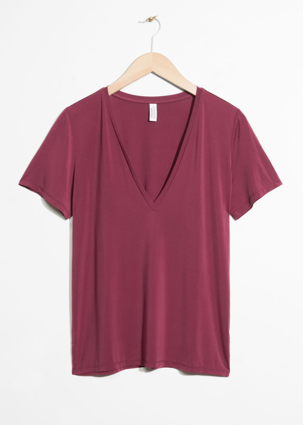 Front image of Stories v-neck cupro top in red