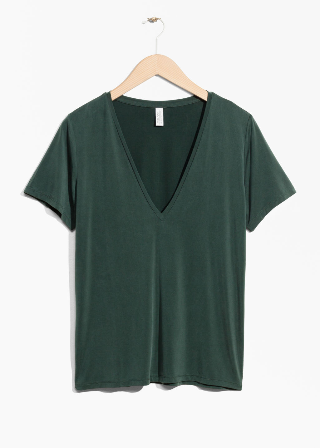 Front image of Stories v-neck cupro top in green
