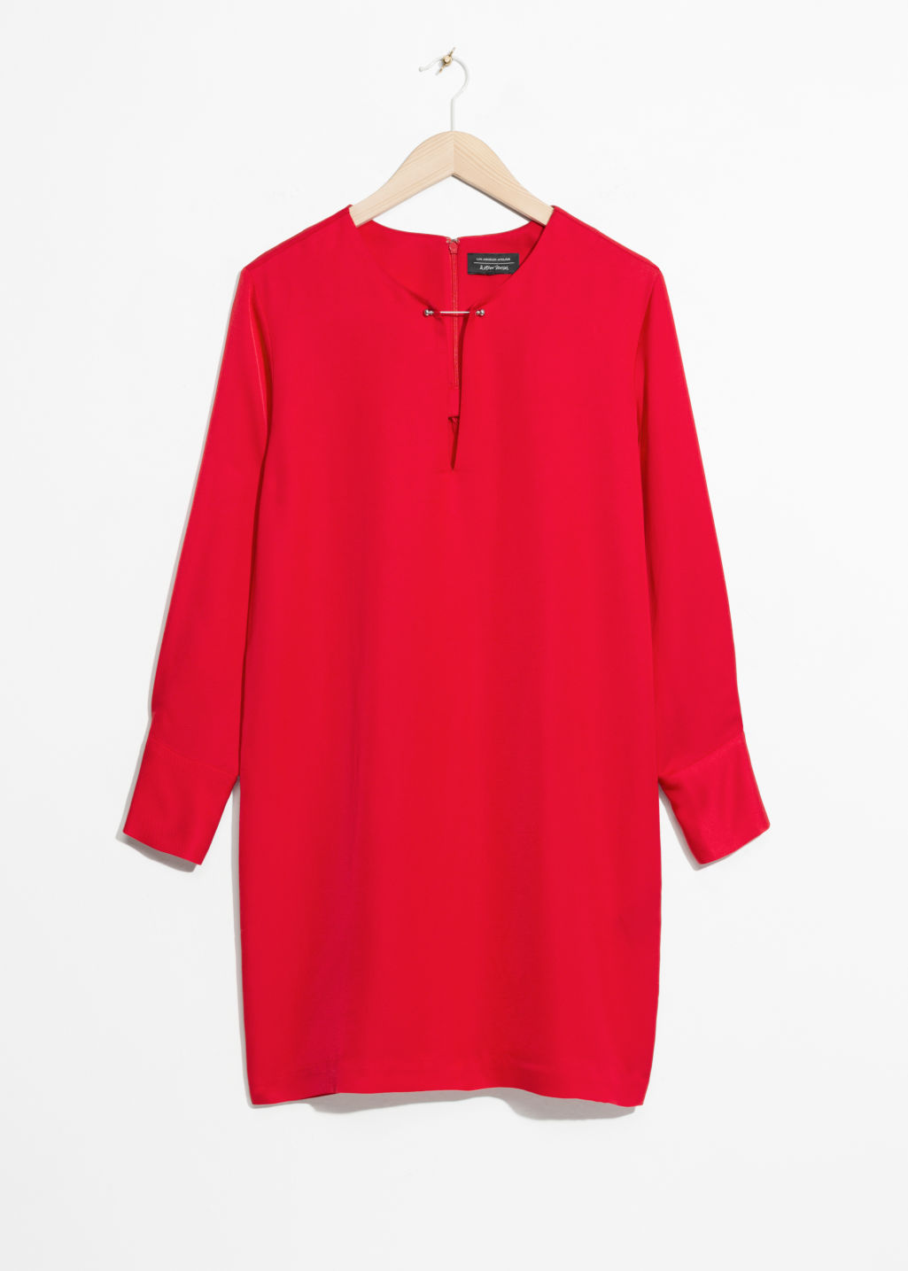 Front image of Stories metal bar detail dress in red