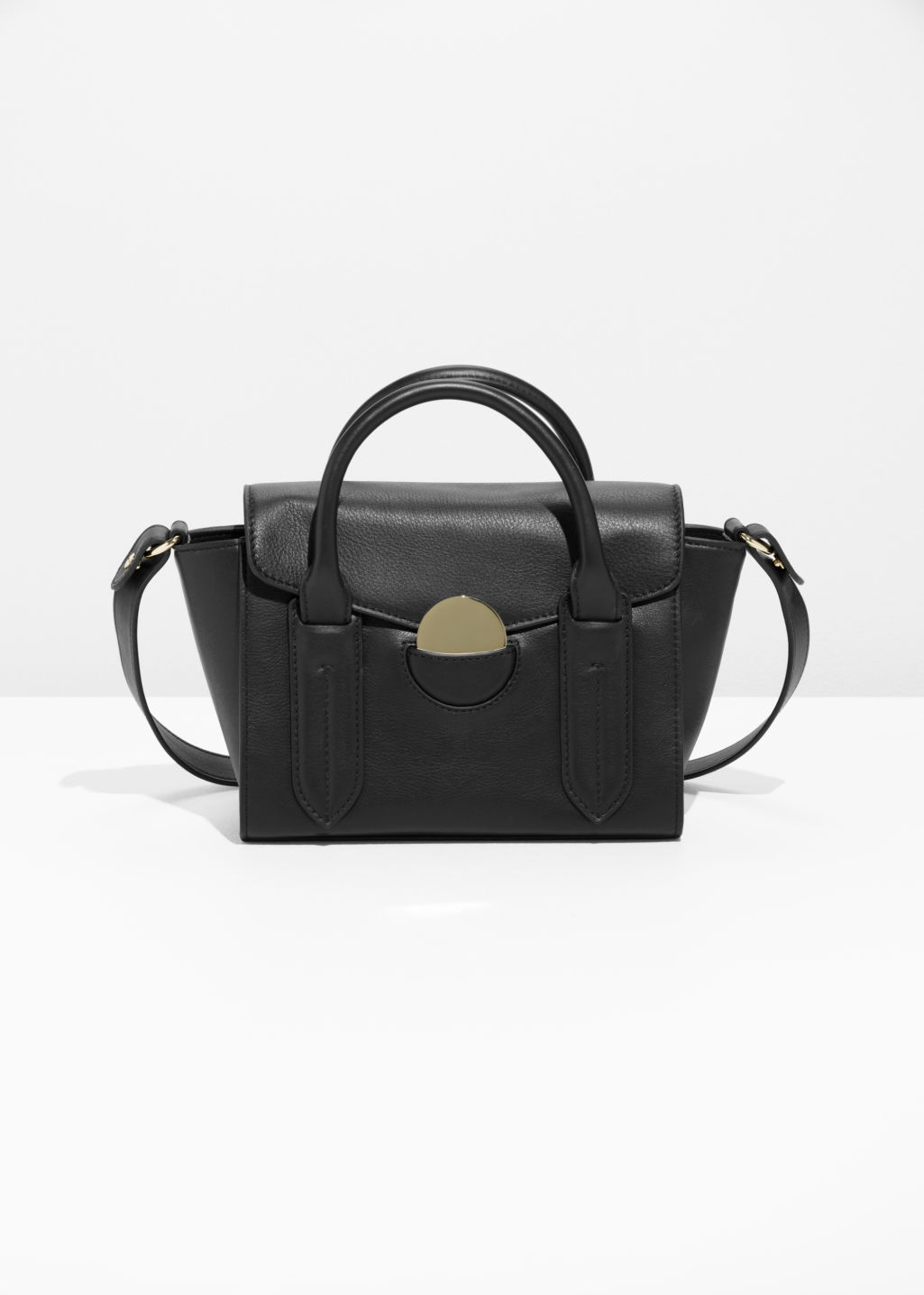 Front image of Stories circle detail leather bag in black