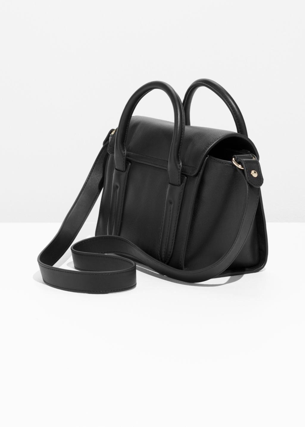 Back image of Stories circle detail leather bag in black