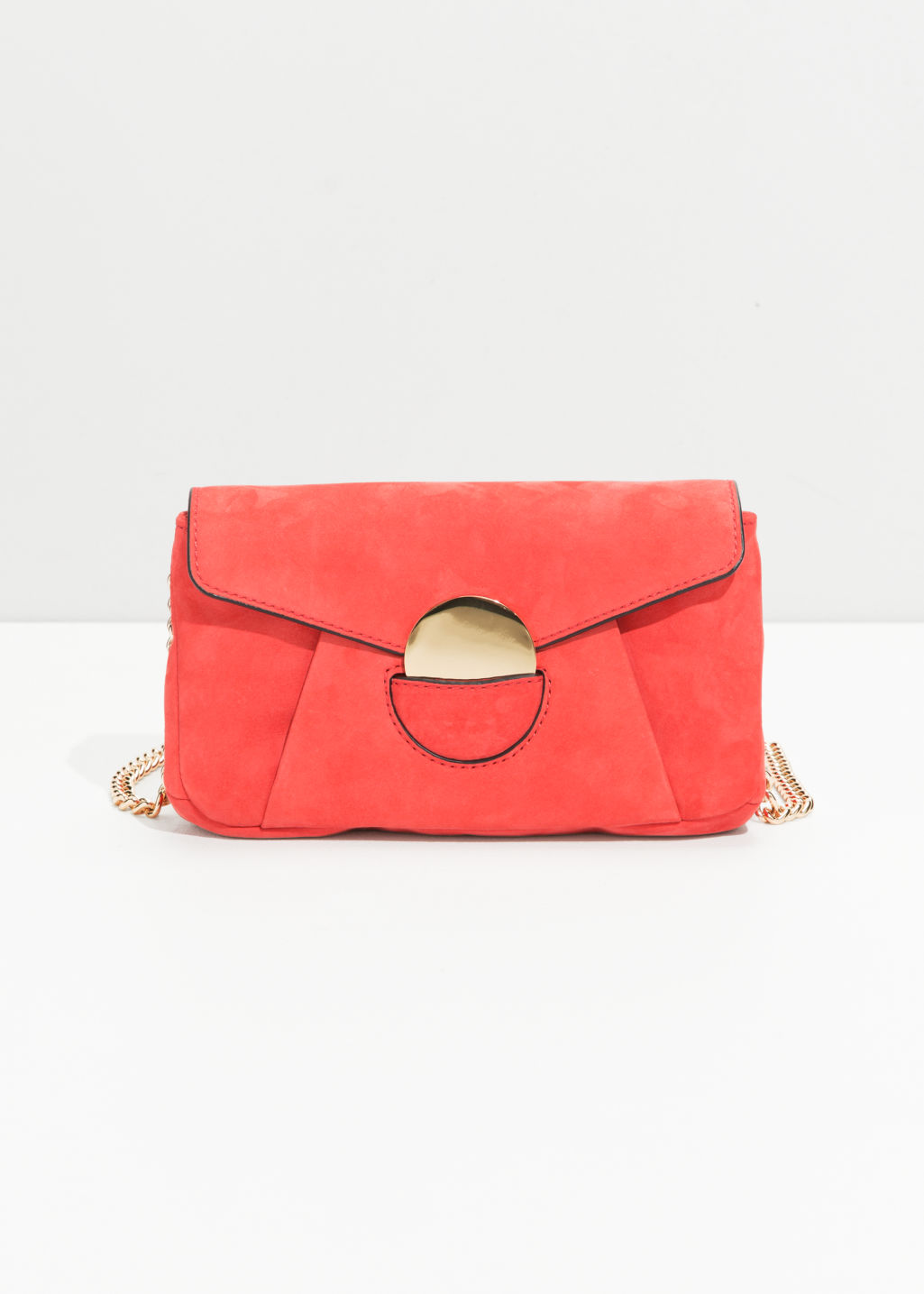 Front image of Stories circle detail leather mini bag in red