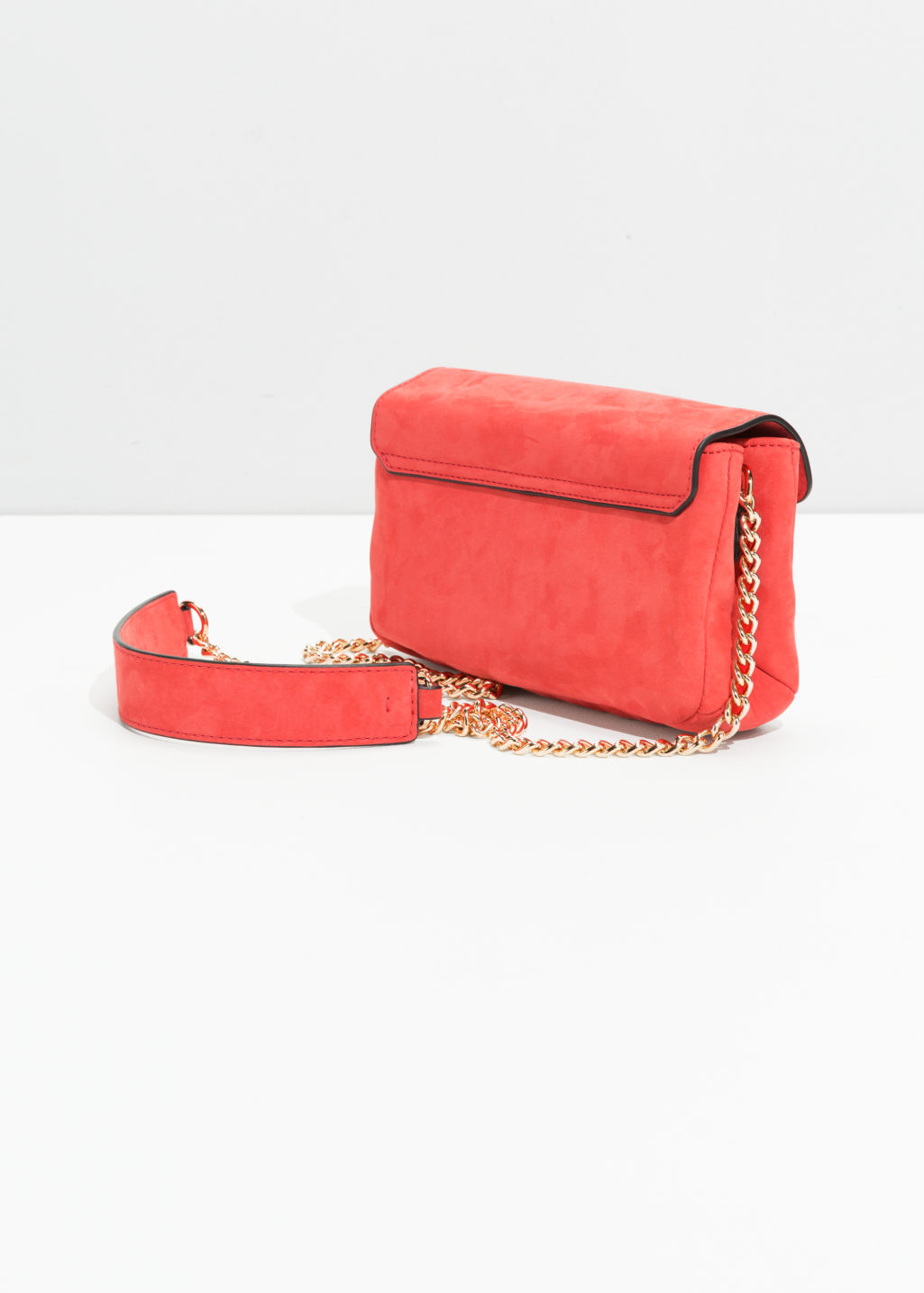 Back image of Stories circle detail leather mini bag in red
