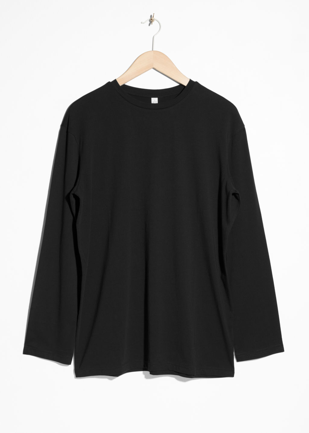 Front image of Stories cotton top in black