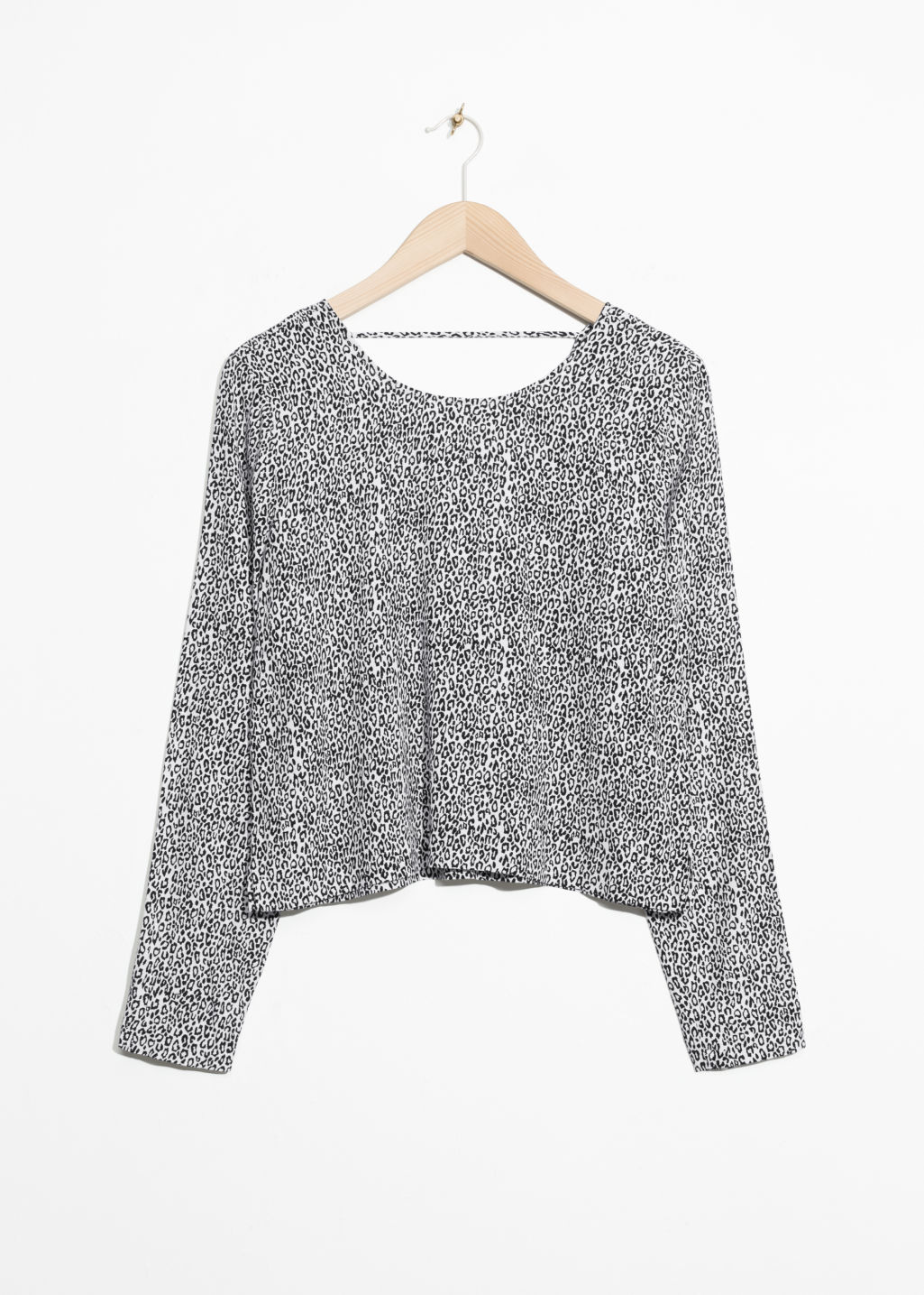 Front image of Stories v-cut back sweater in white