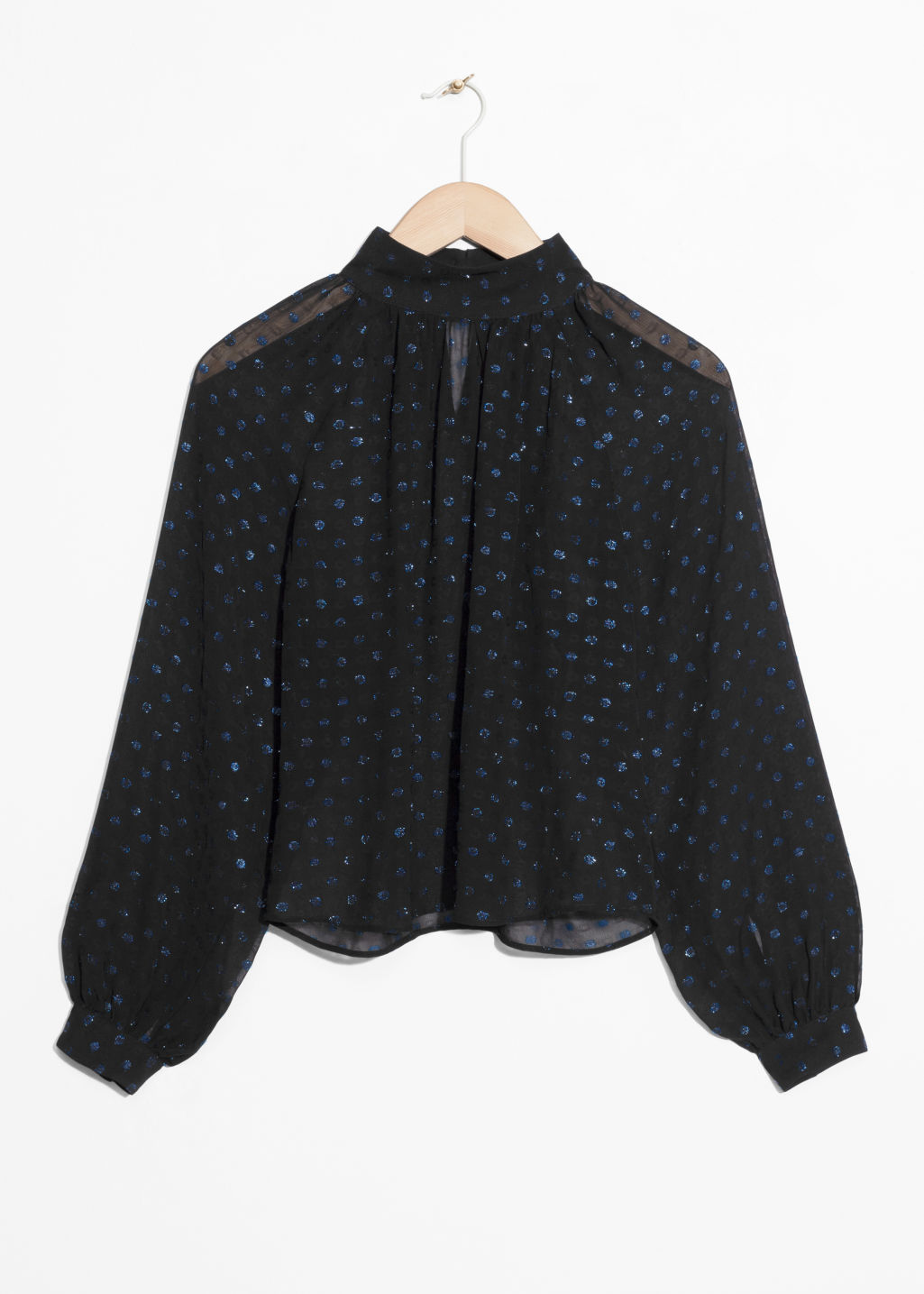 Front image of Stories sheer sequin blouse in black
