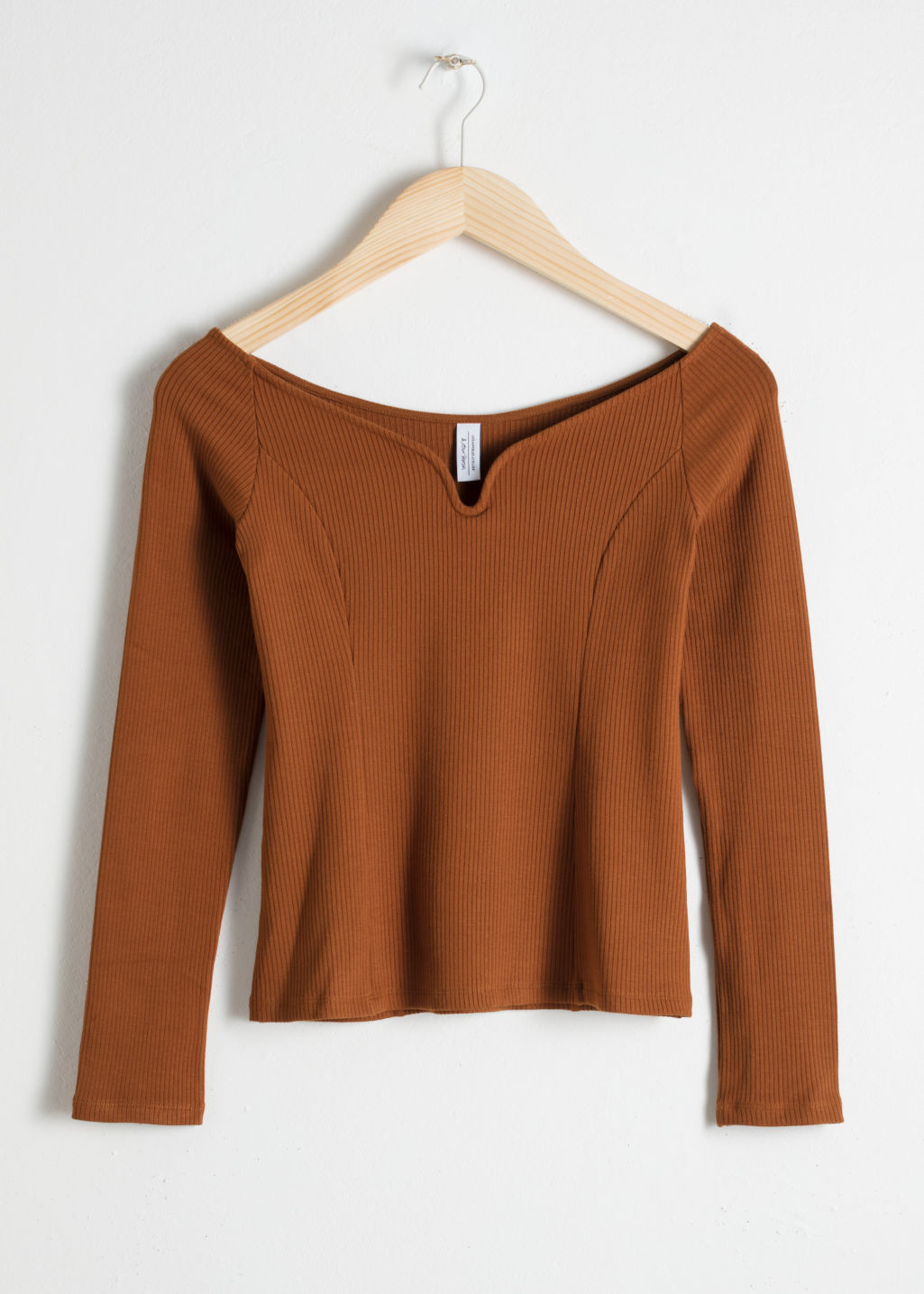 Front image of Stories fitted dip neck top in brown