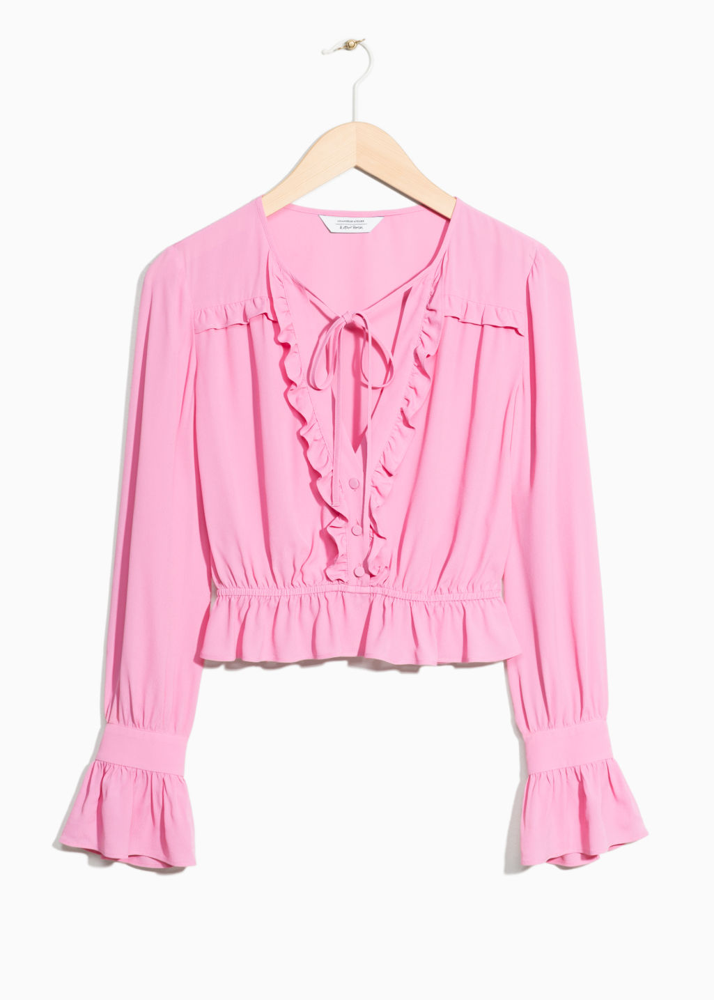 Front image of Stories ruffled blouse in pink