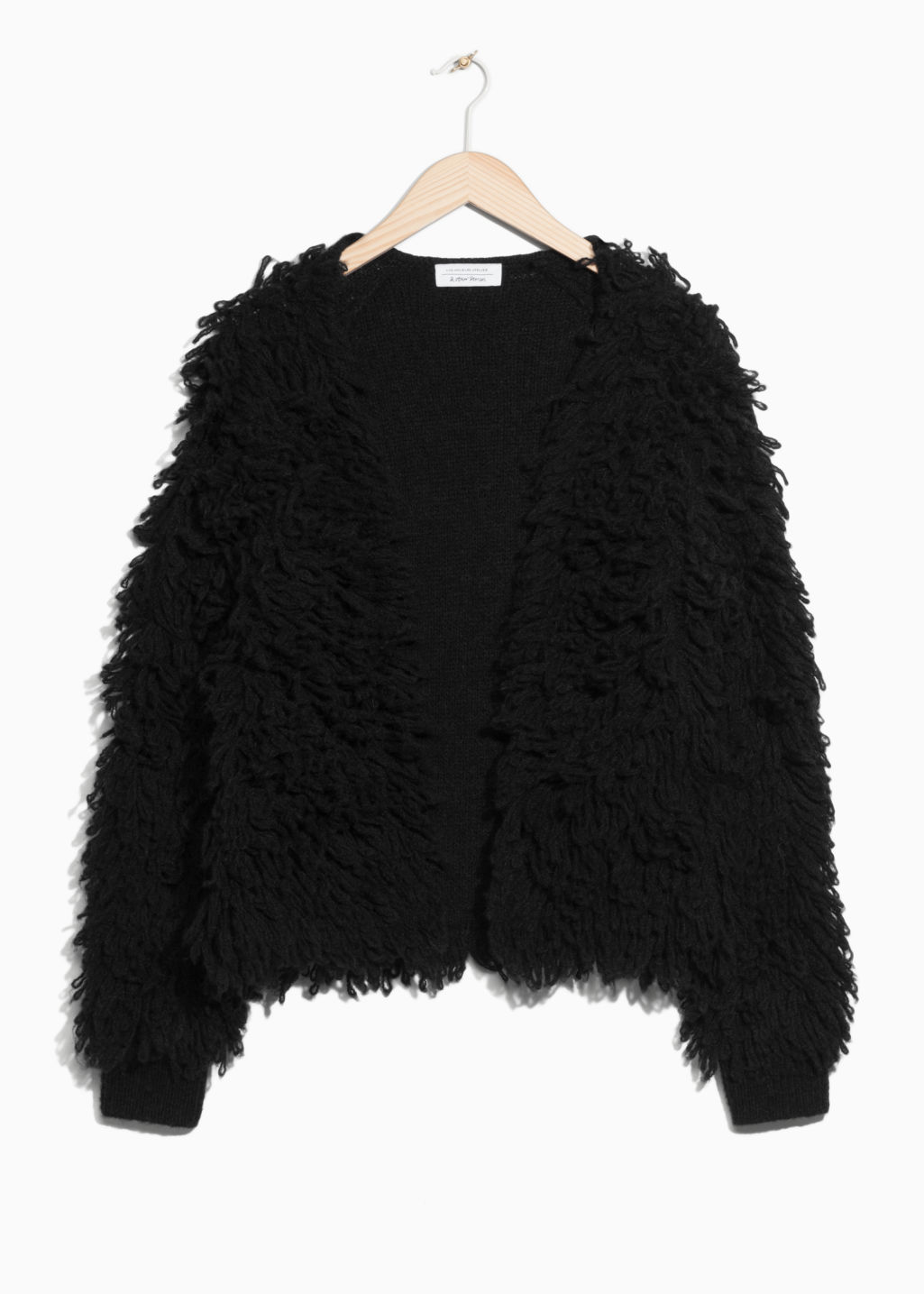 Front image of Stories shaggy wool-blend knit in black