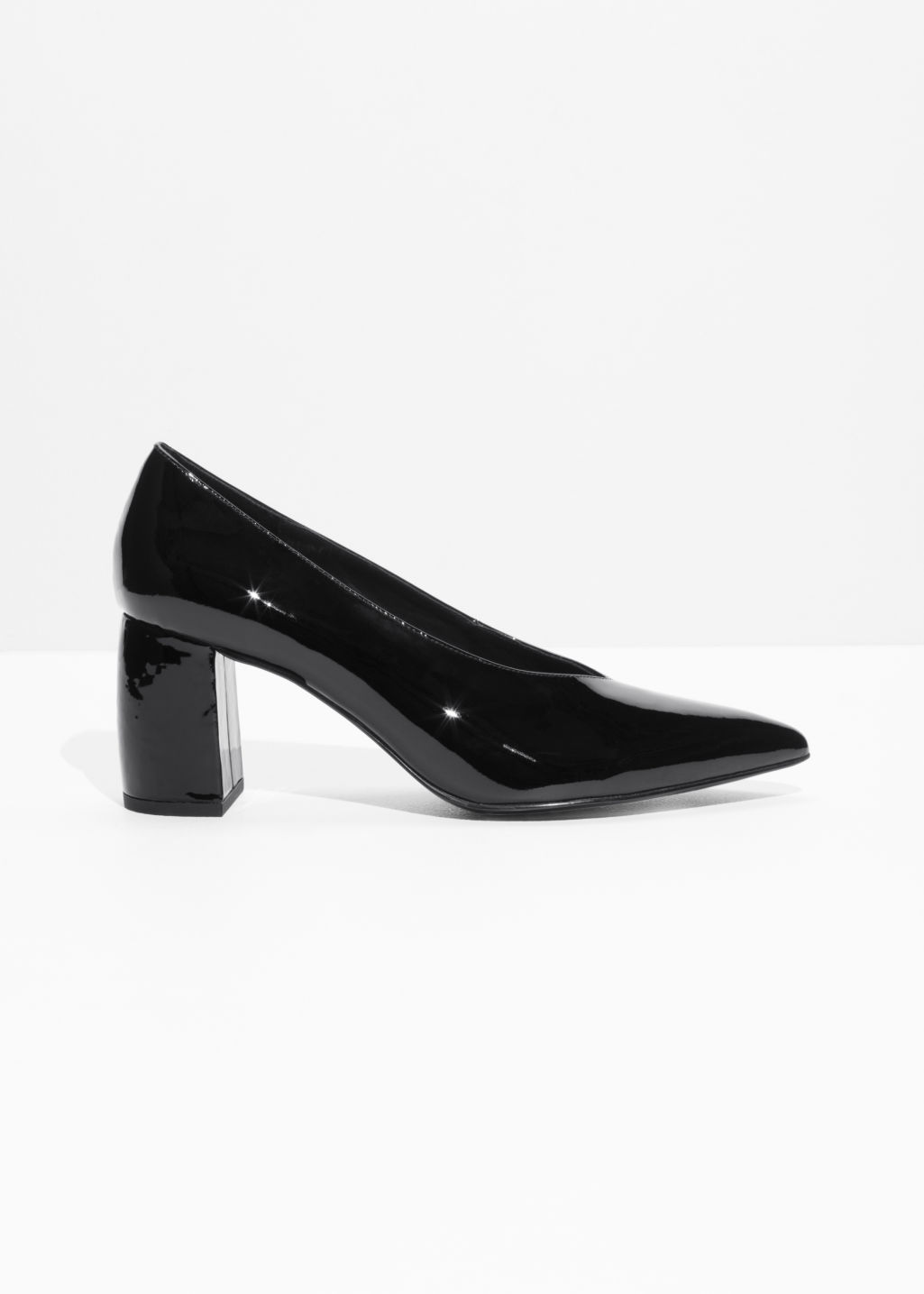 Front image of Stories patent leather pumps in black