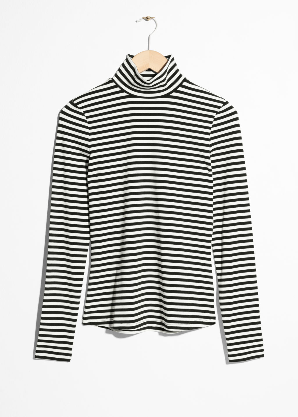 Front image of Stories striped jersey turtleneck in black