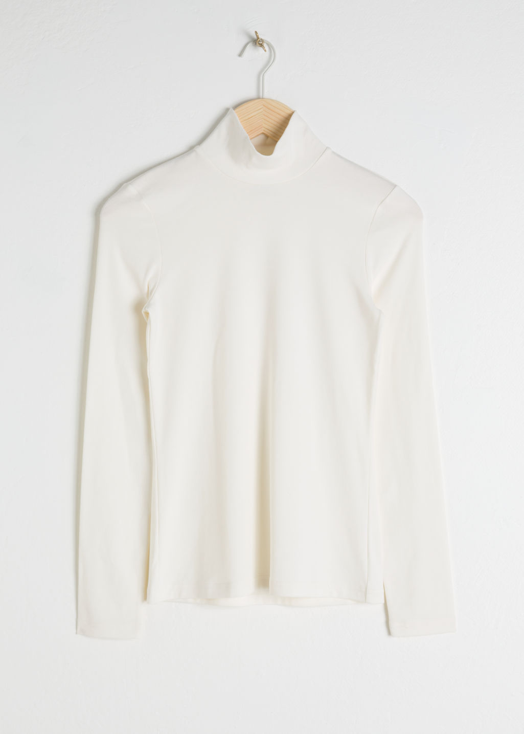 Front image of Stories striped jersey turtleneck in white