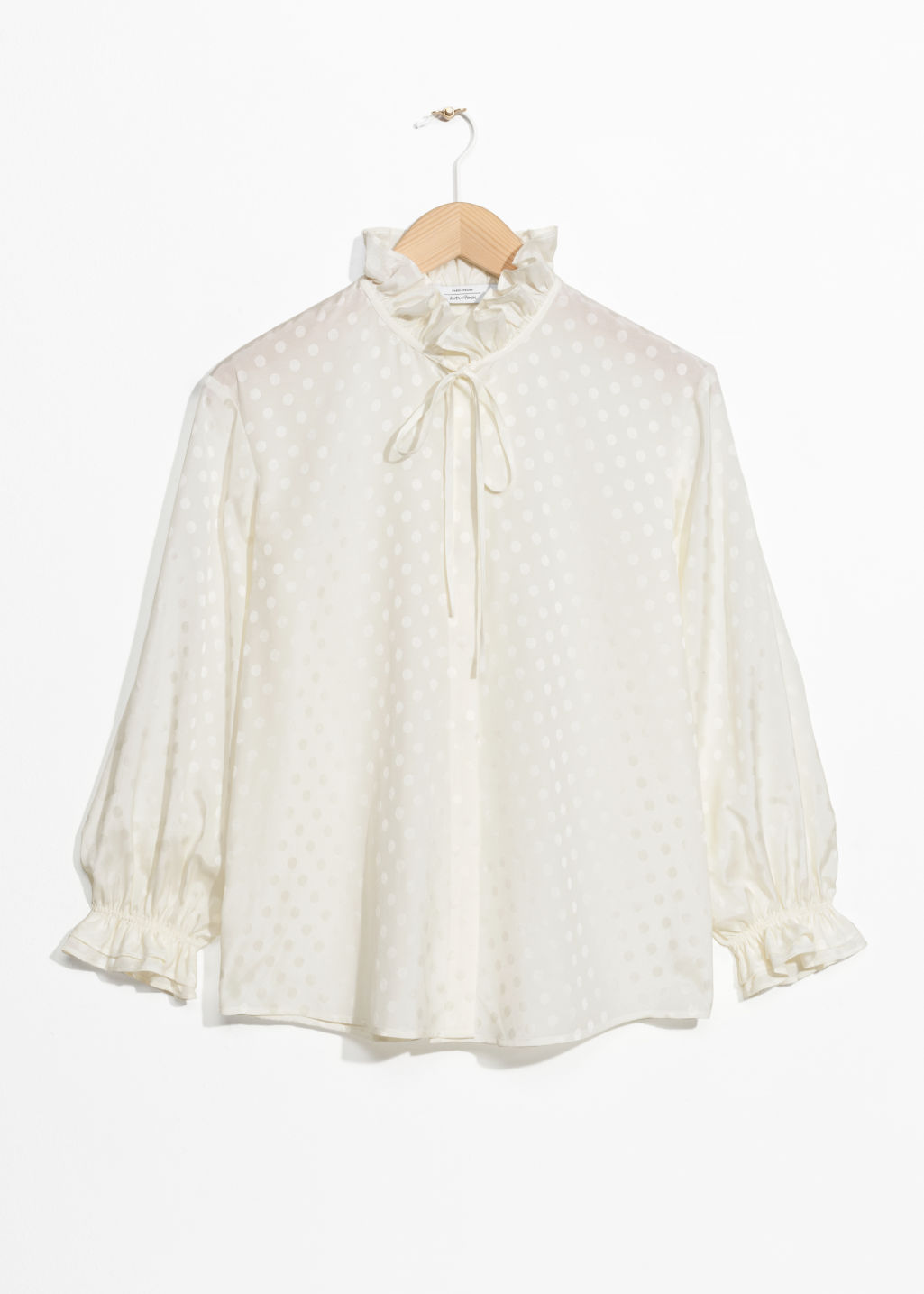 Front image of Stories ruffle collar blouse in white