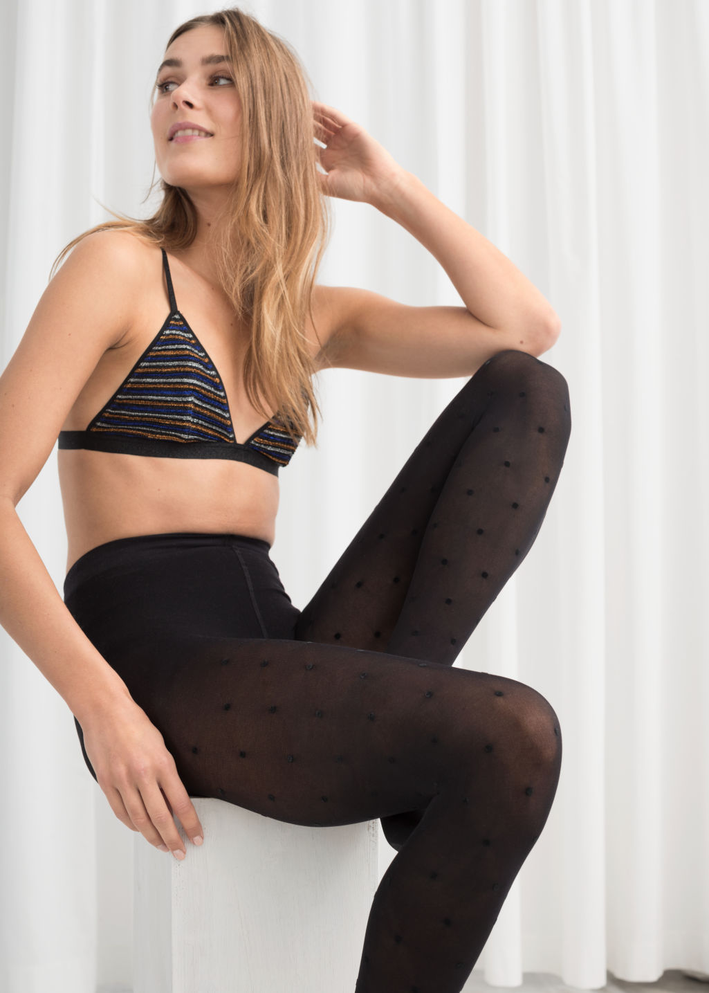 Front image of Stories dot tights in black