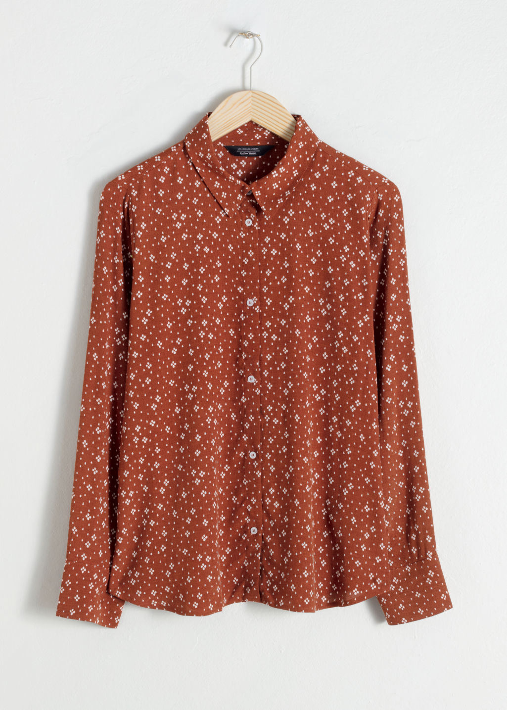 Front image of Stories button up blouse in orange