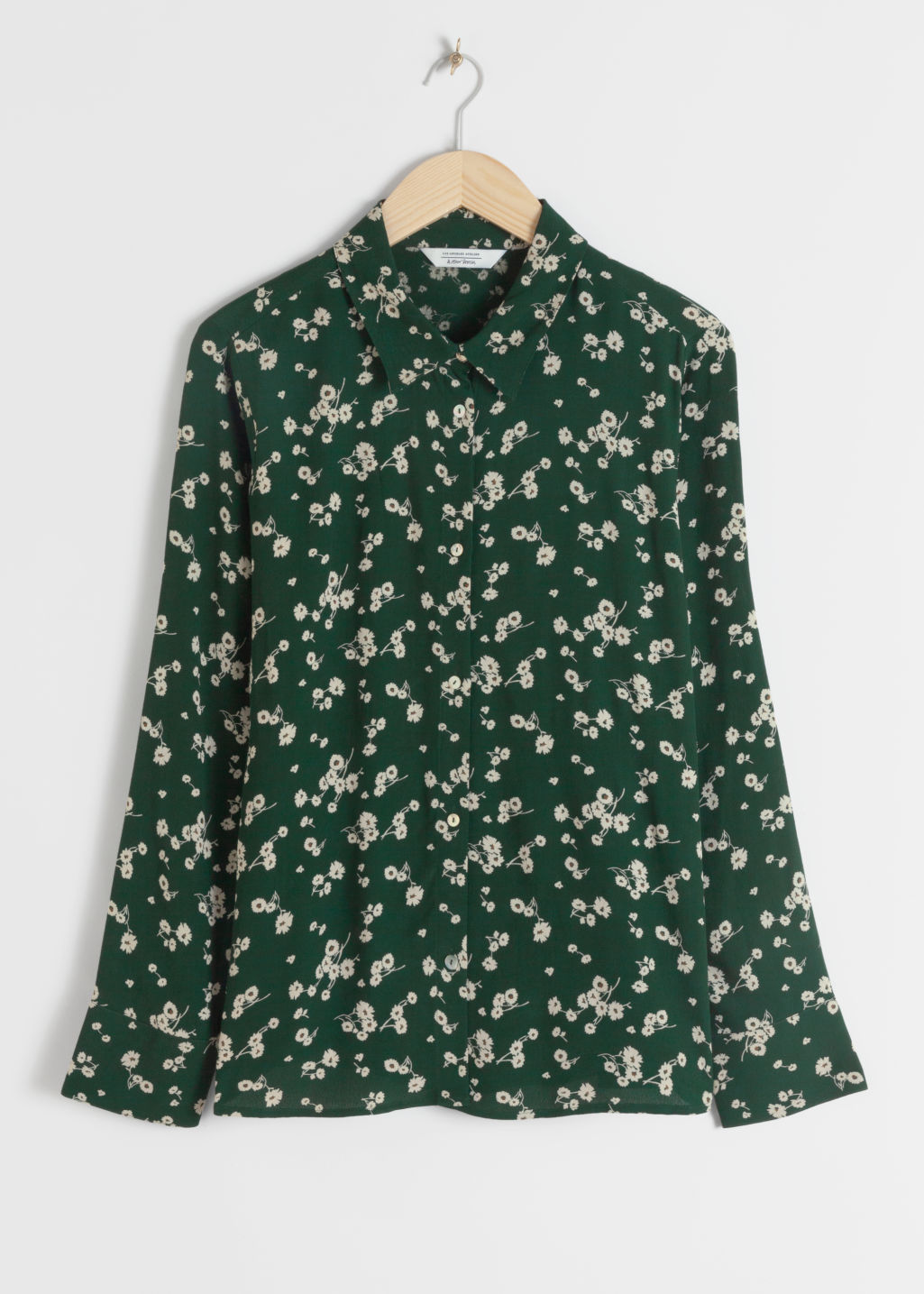 Front image of Stories button up blouse in green