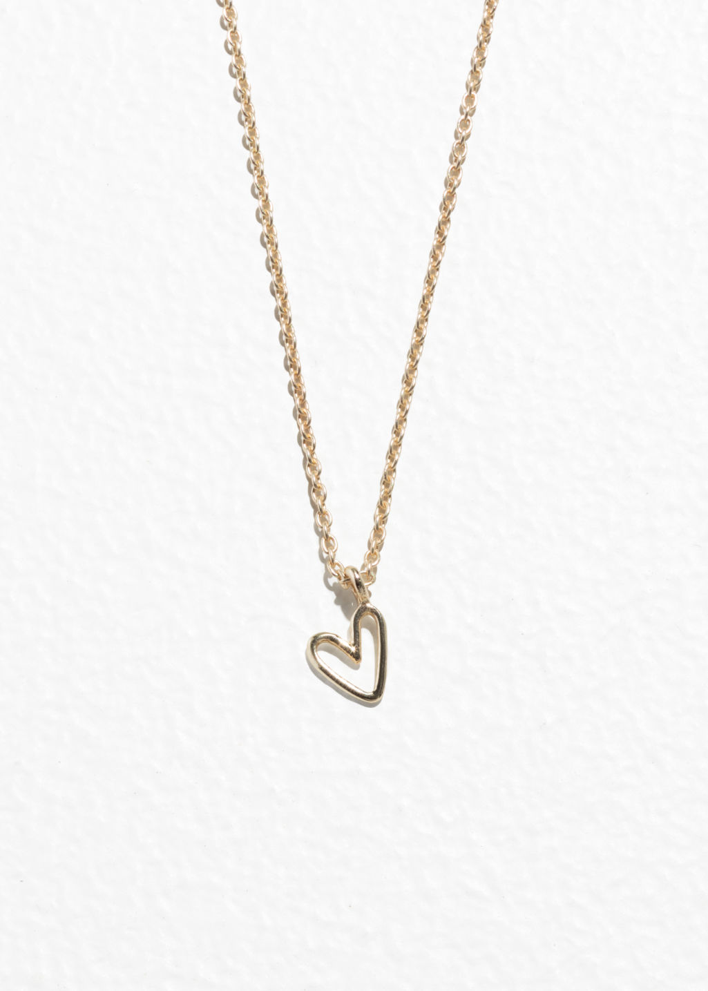 Front image of Stories heart pendant necklace in gold
