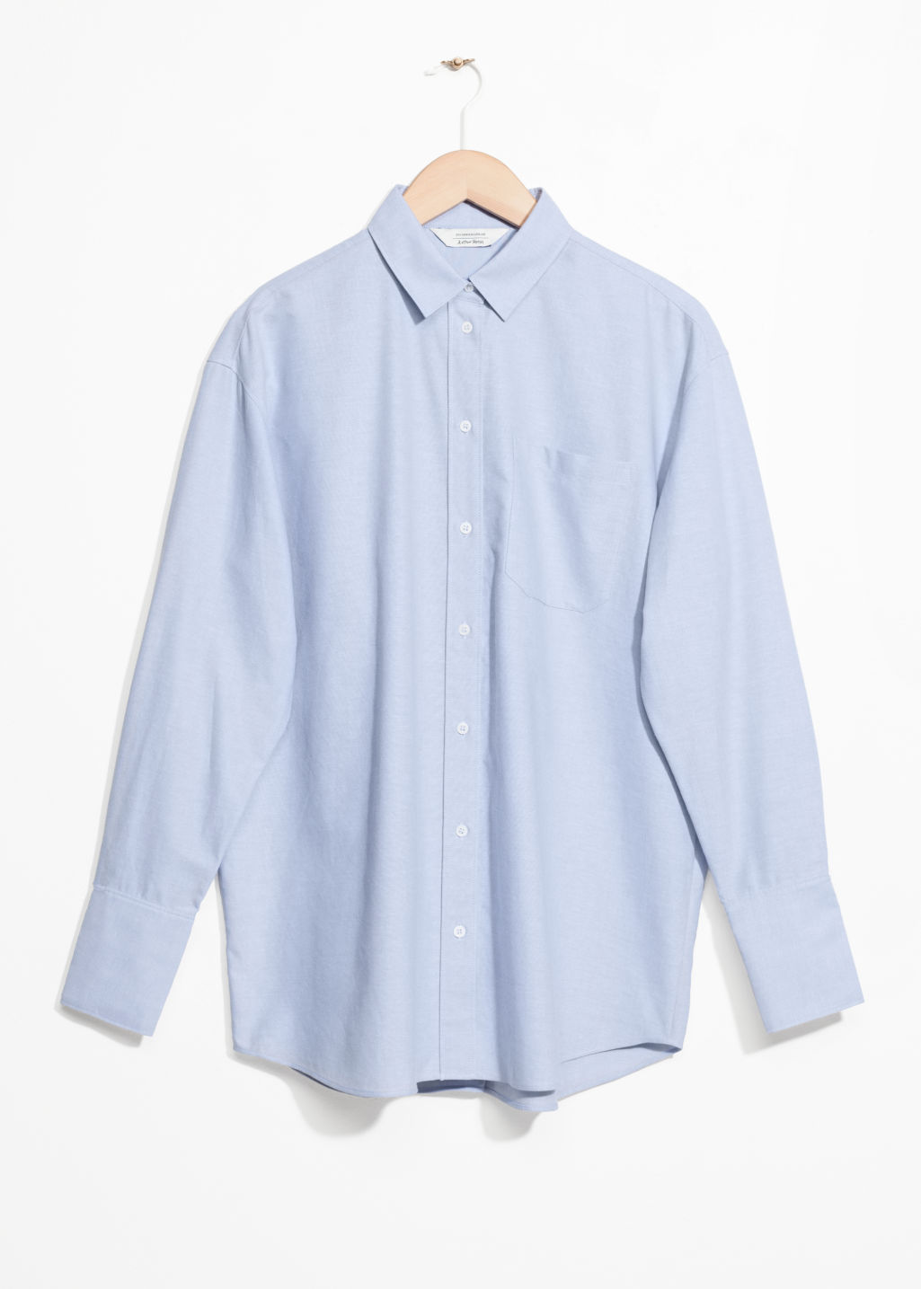 Front image of Stories oversized button down shirt in blue