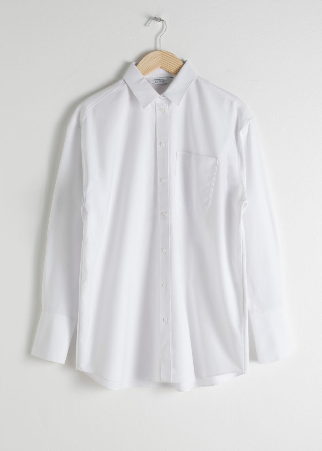 Front image of Stories oversized button down shirt in white
