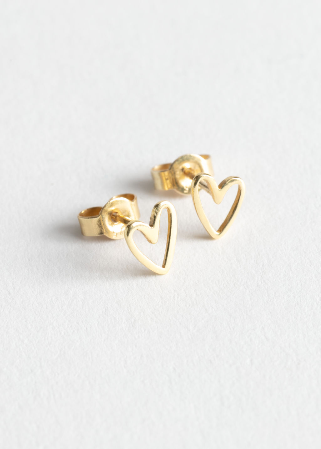 Front image of Stories heart studs in gold