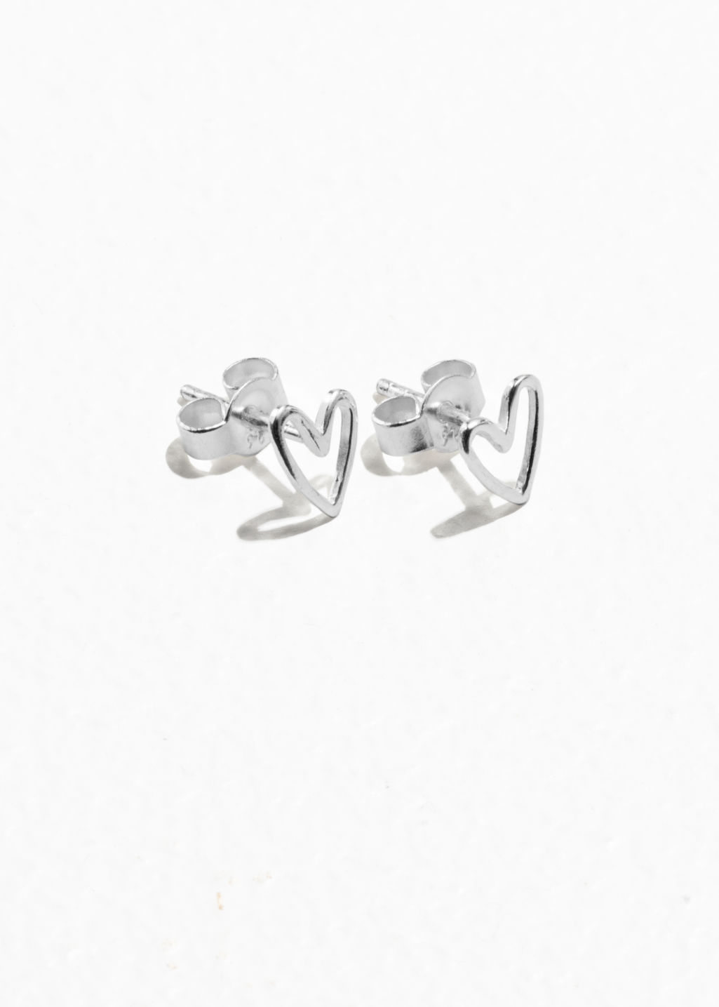Front image of Stories heart studs in silver