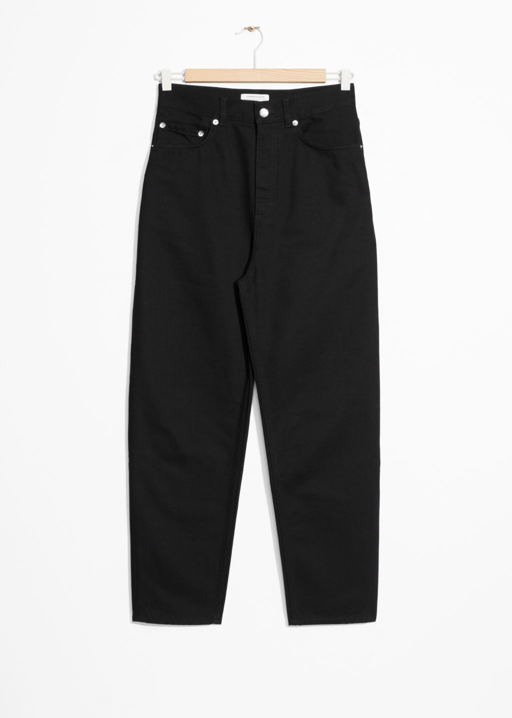 Front image of Stories tapered ankle jeans in black
