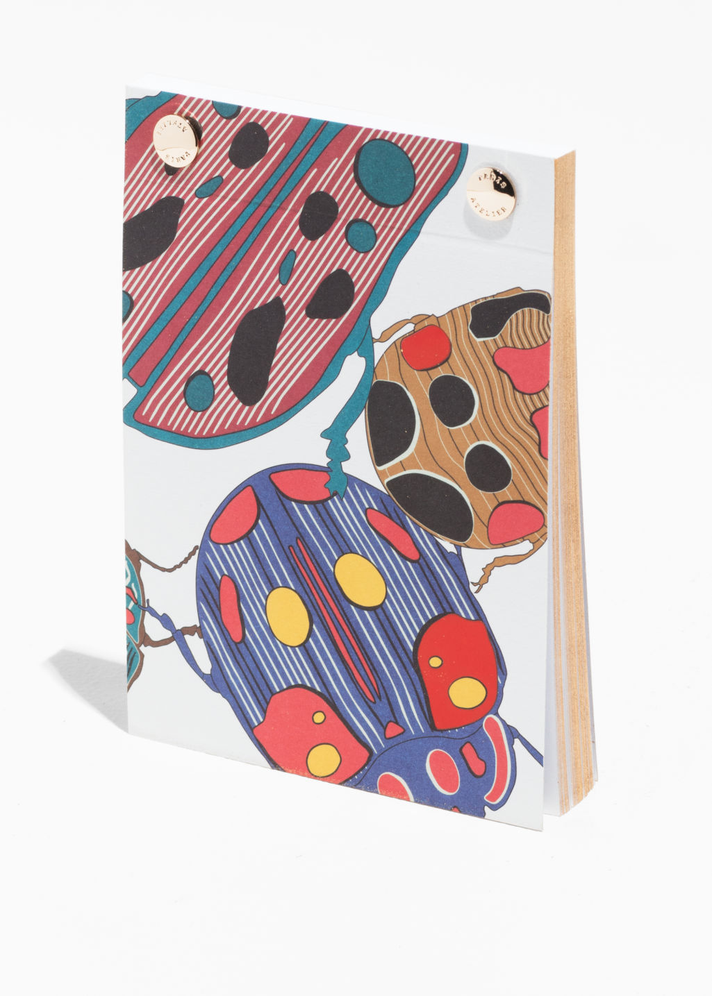Front image of Stories scarab a6 notebook in white