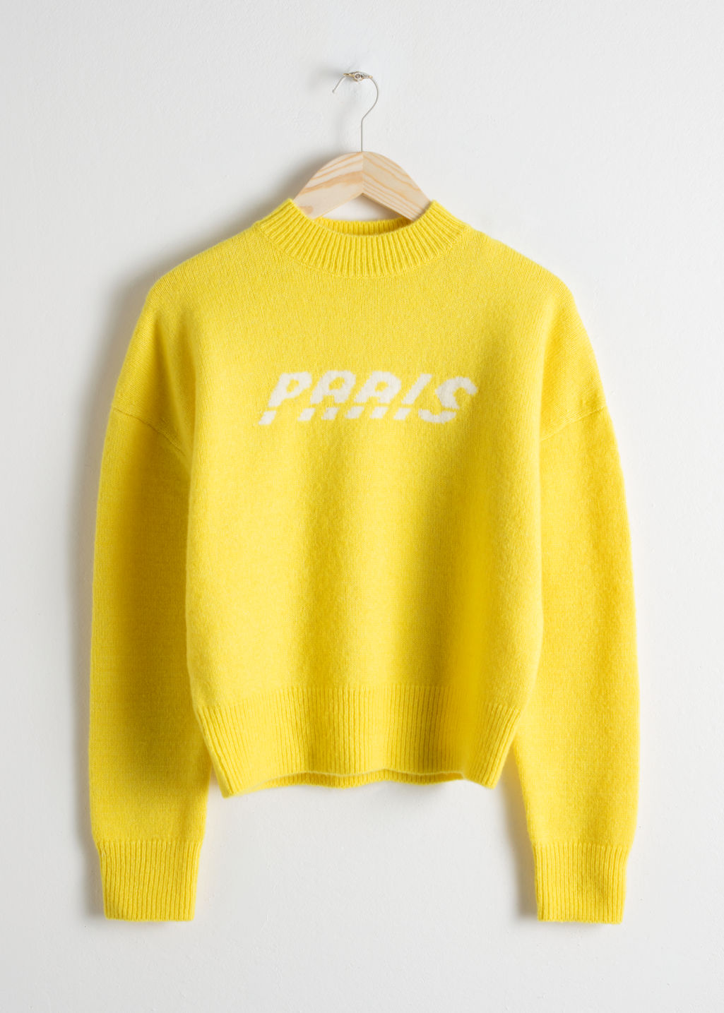 Front image of Stories paris sweater in yellow