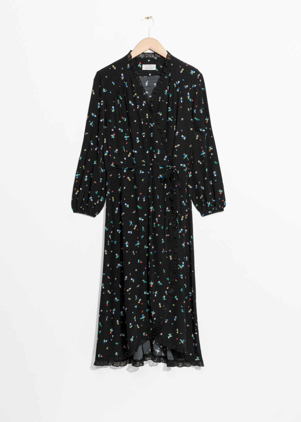 Front image of Stories ruffled wrap dress in black