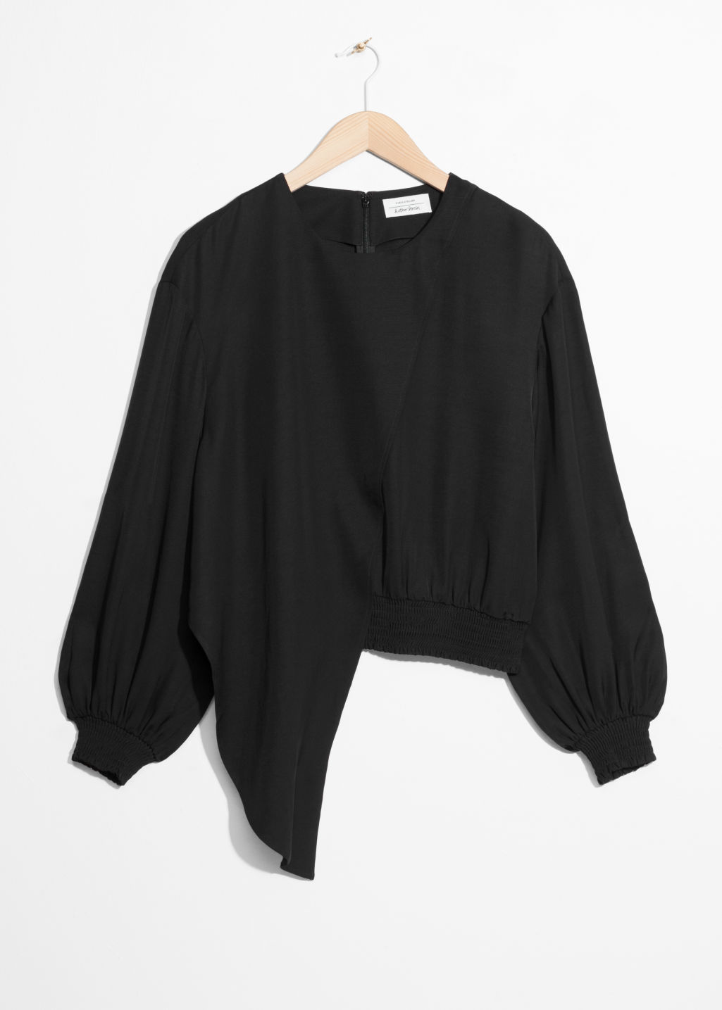 Front image of Stories asymmetrical blouse in black