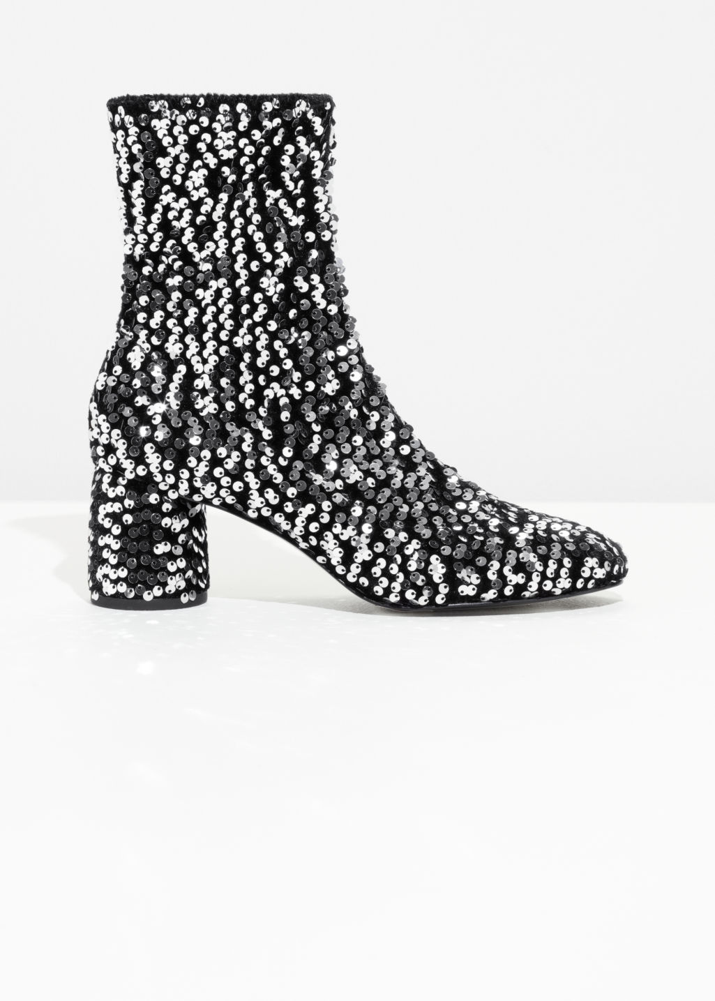 Front image of Stories sequin velvet boots in silver
