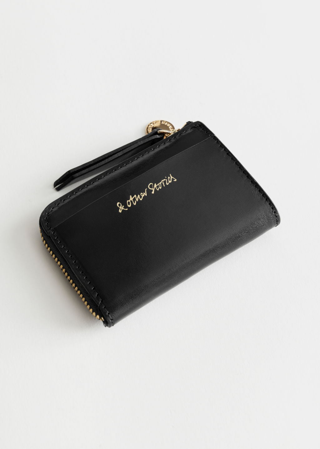 Front image of Stories charm mini wallet in black