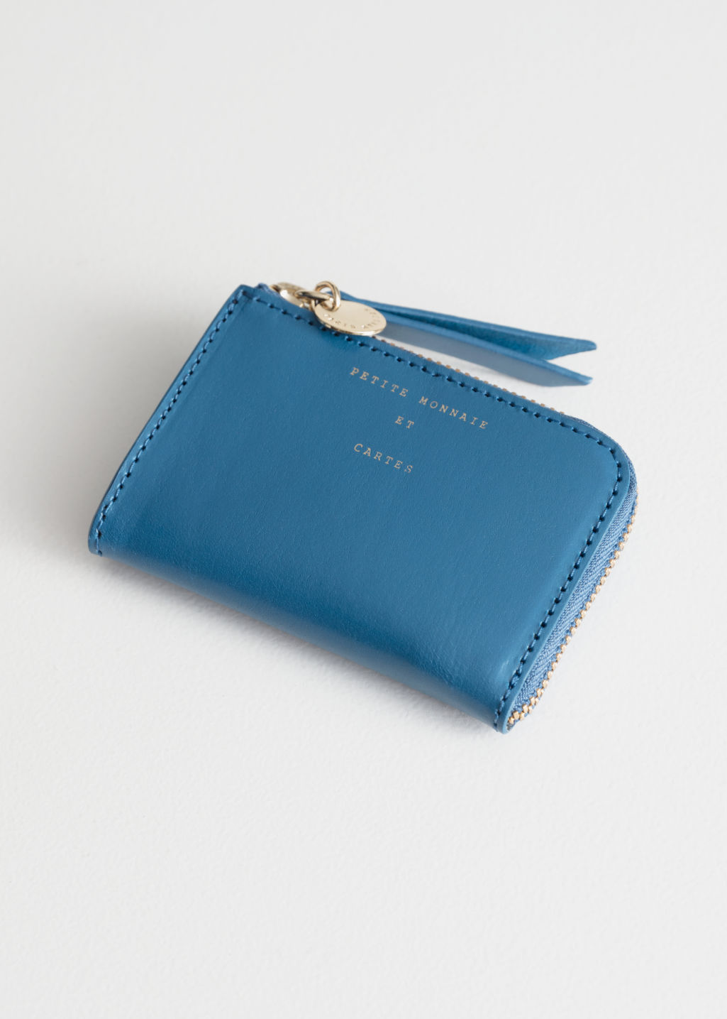Front image of Stories charm mini wallet in blue