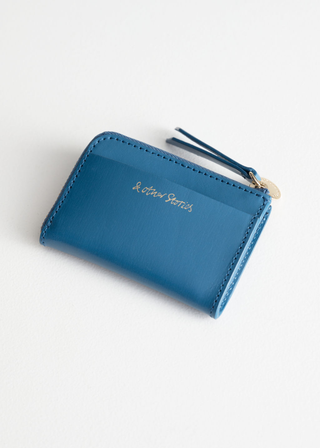 Back image of Stories charm mini wallet in blue