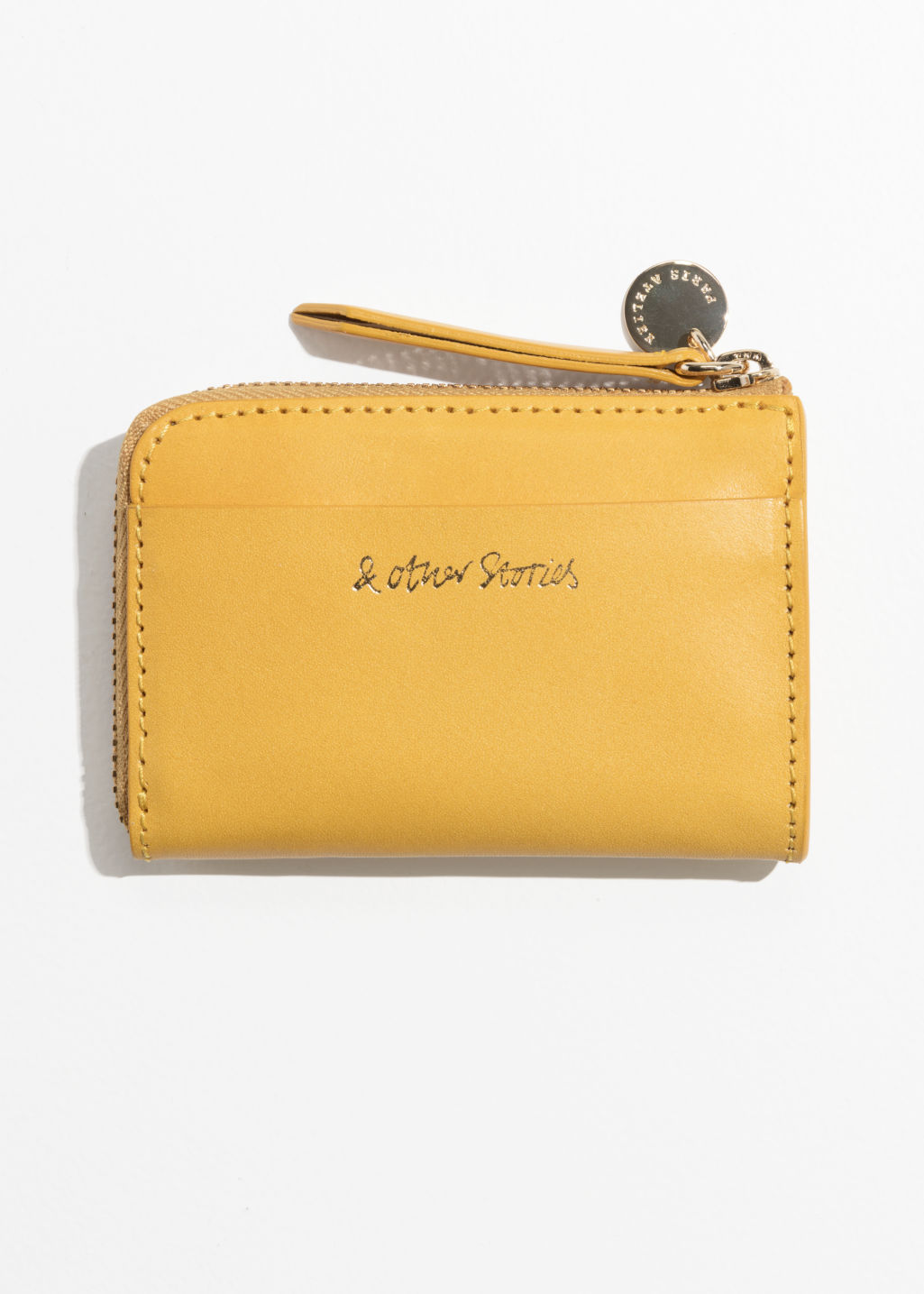 Front image of Stories charm mini wallet in yellow