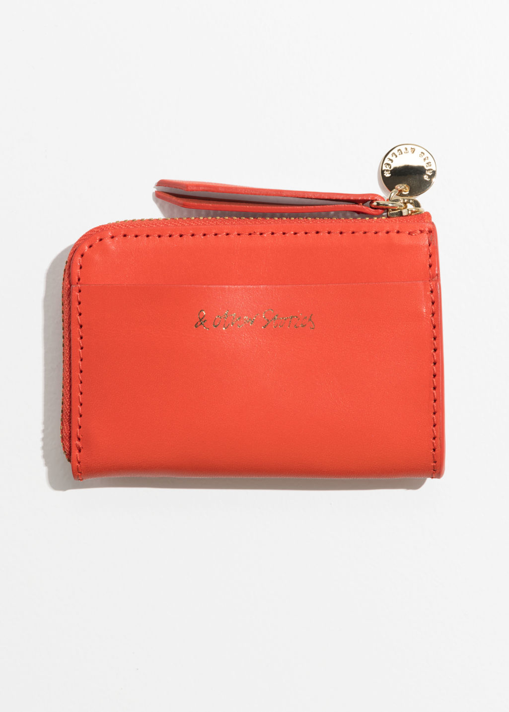 Front image of Stories charm mini wallet in orange