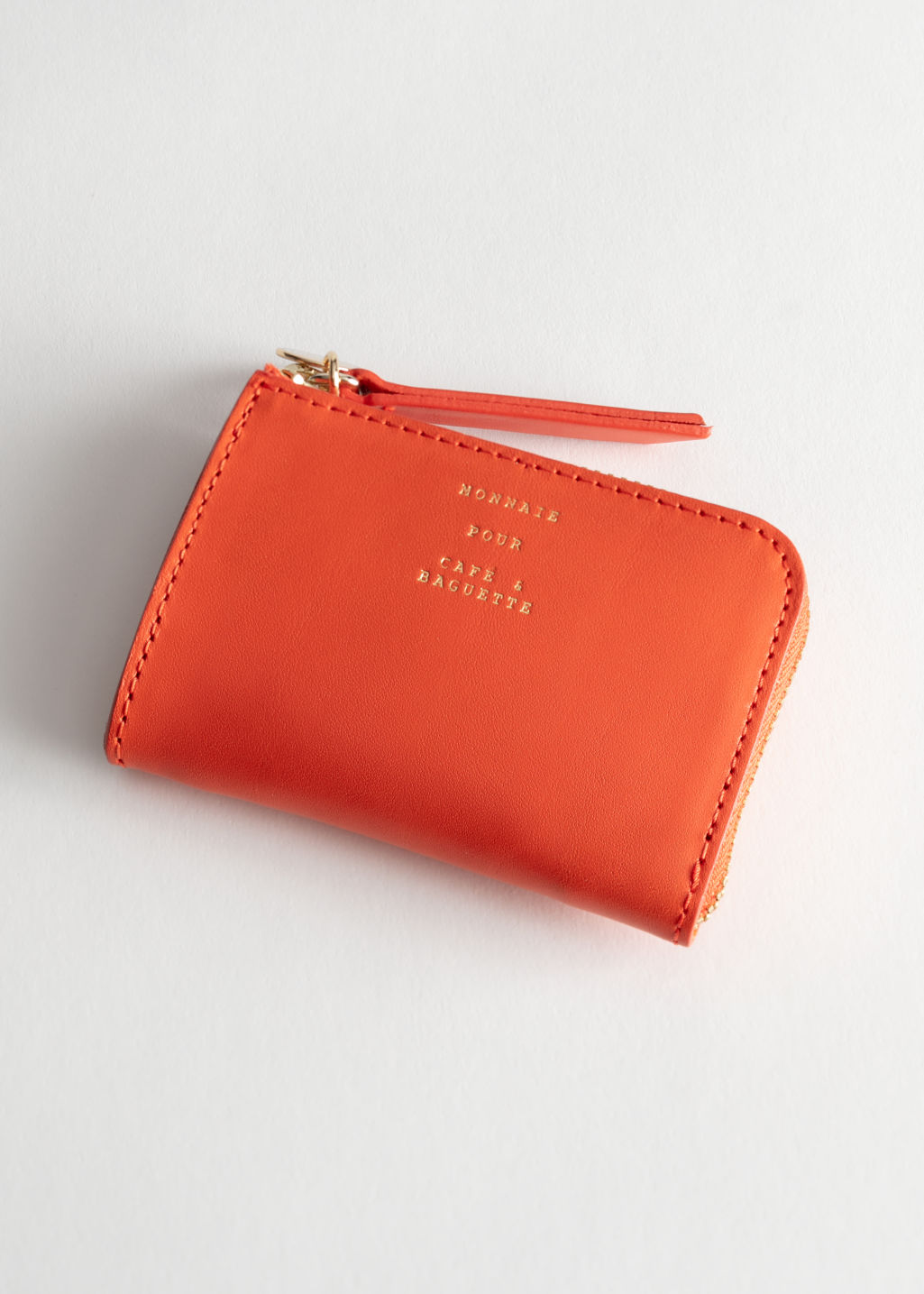 Back image of Stories charm mini wallet in orange