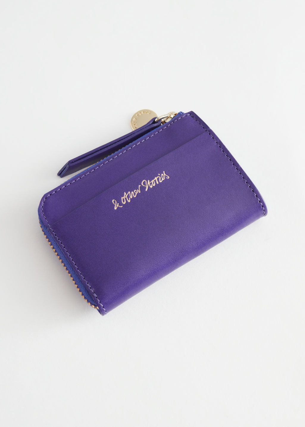 Front image of Stories charm mini wallet in purple
